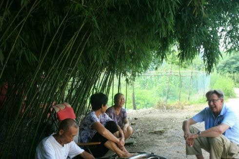 Talking with farmers in small village near Tangzhi